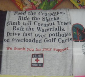 photo of t shirt about feeding crocodiles, riding sharks, doing dangerous things